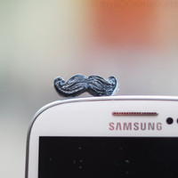 Mustache phone accessory. Movember plug for earphone jack. Fits iPhone 5 4 4s ,iPad ,Samsung galaxy s2 s3, 3.5mm output. Ohtteam for all