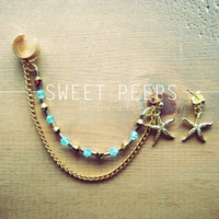 Gold Ear Cuff with Gold Starfish and a string of Beautiful Light Blue Crystals and BONUS Starfish Earring