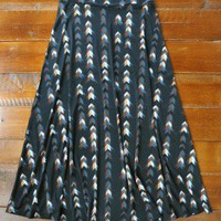 Flying Arrows Skirt - $68.00: From ourchoix.com, this boho inspired maxi skirt comes in a trendy palette of arrows on a canvas of black.