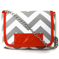 The MAROL Cross body in grey and white chevron with toro orange leather