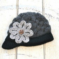 Knitted Floral Cap - $38.00: From ourchoix.com, this thick woven beaniestyle cap is embroidered with a carved wooden button.