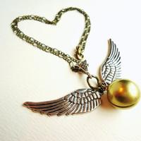 Golden Snitch Locket Harry Potter Momento by ViperCoraraDesigns