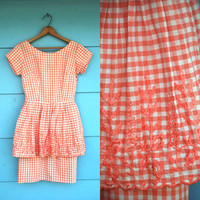 1950s. coral gingham wiggle dress with embroidered peplum. xs