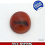 Brown red black oval semitransparent agate with iron oxide inclusion