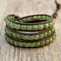 Green beaded wrap. Earhty triple wrap leather bracelets. Button closure bracelet