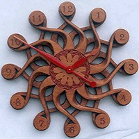 Handcarved Wall ClockSolaris by laughingcoyote on Etsy