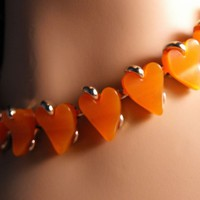 Claudette Orange Lucite Heart Necklace Signed from giltygirlvintage on Ruby Plaza