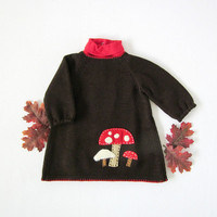 Knitted baby dress in brown with mushrooms. For a baby girl until 3M. 100% wool.