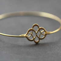 Exotic Knot gold bangle bracelet