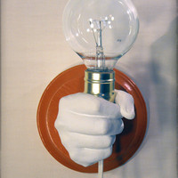 Hand Holding Bulb Wall Lamp Orange by KaraGunter on Etsy