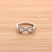 hooked INFINITY ring with crystals, in silver | girlsluv.it