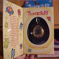 GOLD w/ BLACK BUTTONS~ Tamagotchi ~ ORIGINAL 1997~NEW IN BOX~#1805