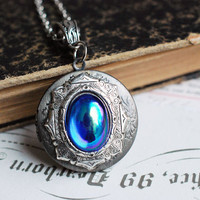 Antique silver round victorian locket necklace - with a vintage blue AB glass cabochon