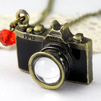 vintage style black camera necklace with red crystal