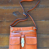 Pumpkin & Spice Messenger - $88.00: From ourchoix.com, a pretty shade of orange that is perfect for Fall. Double front pocket messenger.