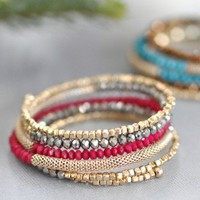 Splash of Magenta Wrap Bracelet - $24.00: From ourchoix.com, this colorful stretchy wrap bracelet is paved with beads of three colors.