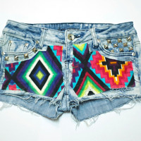 Aztec print on acid wash denim shorts with pyramid studs