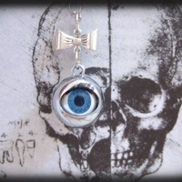 The Evil Doll Eye antique silver blinking eye