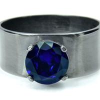 Silver Ring with Deep Blue Sapphire on a Wide Band