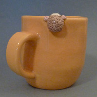 Yellow mug with hedgehog by SBEarthenworks on Etsy