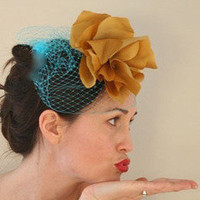 Le Chic Studio ? Josephine - Turquoise Birdcage Veil paired with Golden Silk Flower