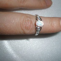 Pretty petite Sterling Fire Opal ring bound with spells of beauty