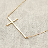 Tiny Sideways Cross Necklace in gold from Flowerdays