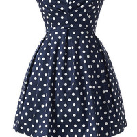 RUBBER DUCKY navy polka-dot cotton mini with crinoline petti­coat. |