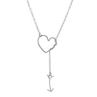 "HEART AND ARROW LARIAT | Inspired by Bon Jovi's ""You give love a bad name,"" artist Deb Soromenho created this handmade charm that turns rocking lyrics into a lyrical work of art. 