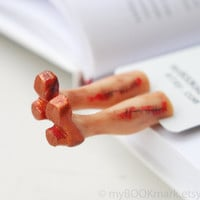 Zombie lady bookmark. Legs in the book. Weird rustic terracotta shoes. Bloody legs. Anti valentine for him, her, all
