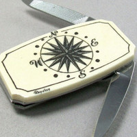 Victorian trading Co. - www.victoriantradingco.com - Scrimshaw Money Clip <i>with Knife & Nail File</i>