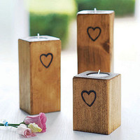 set of three tea light holders by giddy kipper | notonthehighstreet.com