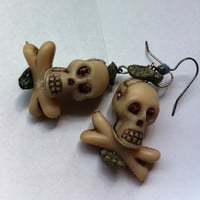 Jeweled eye skull and cross bones earrings