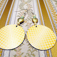 Paper earrings in yellowish orange made from by NellinShoppi