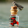 Red butterflies in tiny bottle pendant with by jen4eternity