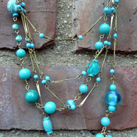 Turquoise Bead Multi Strand Gold Necklace by WanderingLaur on Etsy