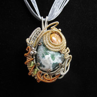 Wire Wrapped Mossy Agate Cabachon wrapped in Coppers