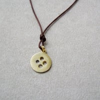 Gold button necklace, gold plated sterling button pendant on a dark brown cord
