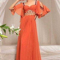 Nigela in orange evening dress with jewelled straps