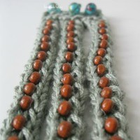 timelessly tri wristlet knitted with beads by handmadefuzzy