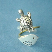 Silver turtle ring with a bird, wrap ring