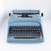 Vintage Blue Typewriter Olivetti Underwood Studio by ItchforKitsch
