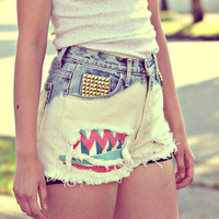 Collective hippie. Tribal inspired studded shorts.  Vintage acid wash.  one-of-a-kind