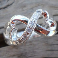http://www.artfire.com/ext/shop/product_view/pavlos/6307607/sivler_plated_zirconium_ring_size_7/design/jewelry/rings/other