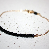 fusca - matte black - lucky gold bracelet by lilla stjarna - gifts under 25 - gold and black bracelet - stacking bracelet - dainty bracelet
