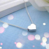 Dainty Heart Necklace in Silver from p.s. I Love You More Boutique