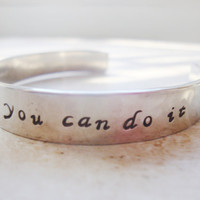 Walt Disney quote hand stamped on a silver hammered bangle cuff