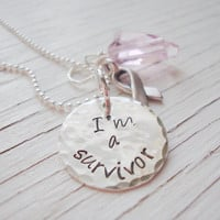 I'm a survivor hand stamped silver disc with heart swarovski crystal pendant and ribbon charm