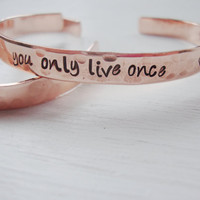 You only live once hand stamped hammered copper cuff