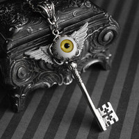 Winged skeleton key necklace with yellow eyeball cabochon - gothic - steampunk jewelry